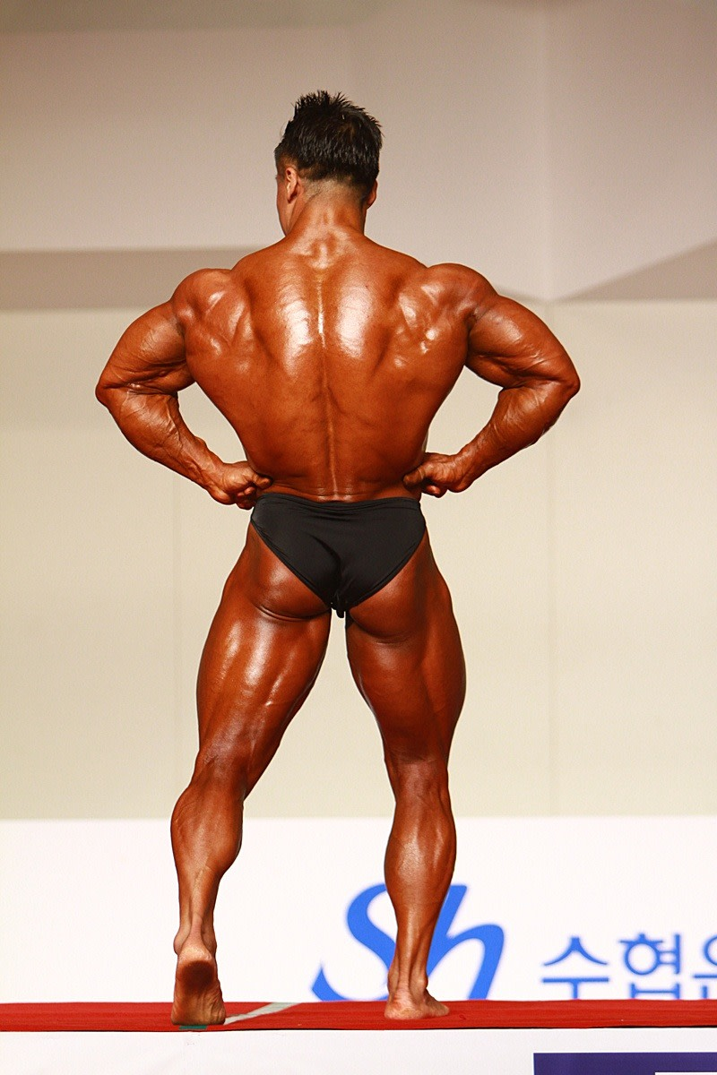Korean bodybuilder Park Ki Seok (박기석) doing a rear lat spread at the 2012 National Sports Festival