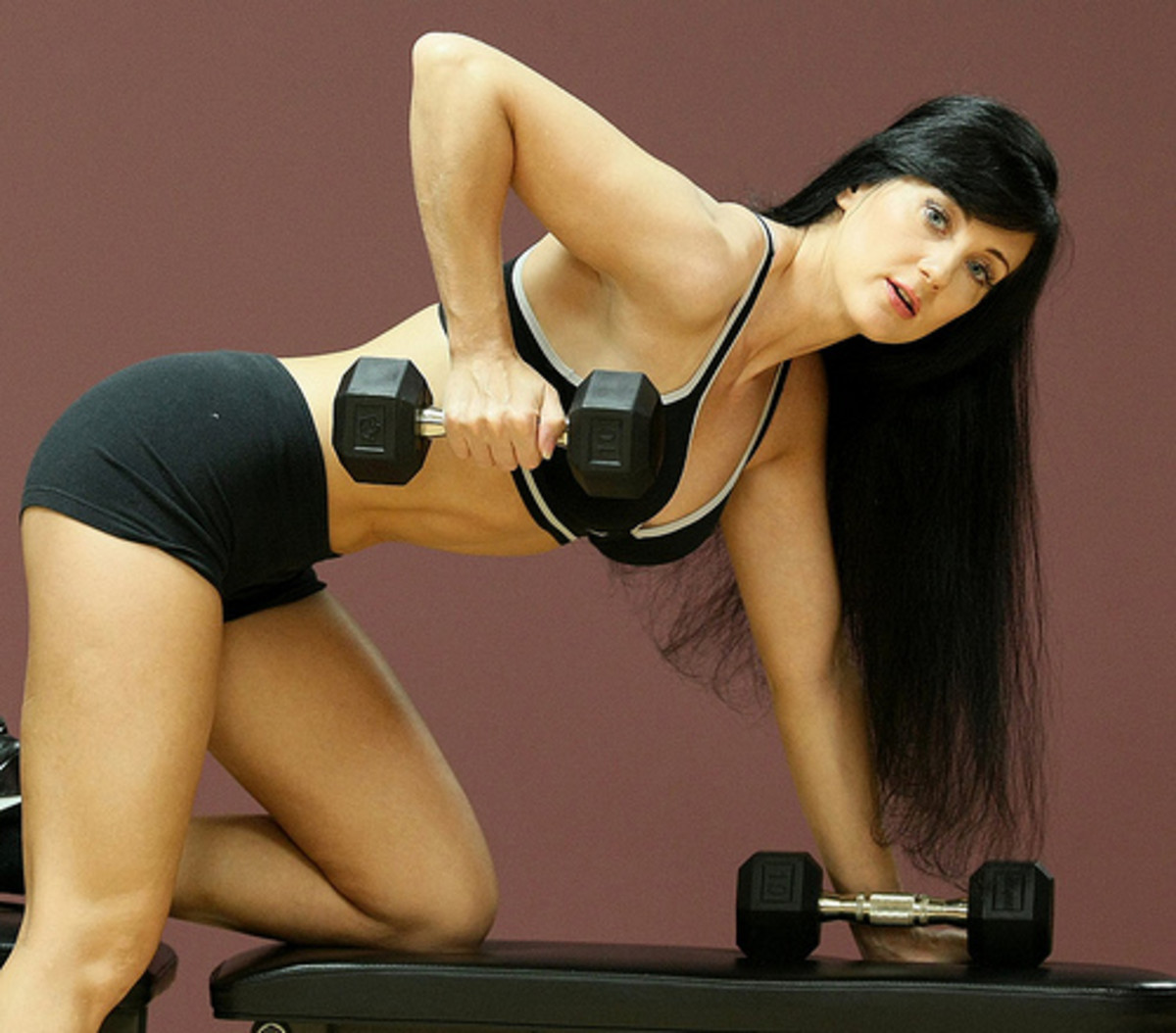 Dumbbell bent-over rowing is great for the back and biceps.