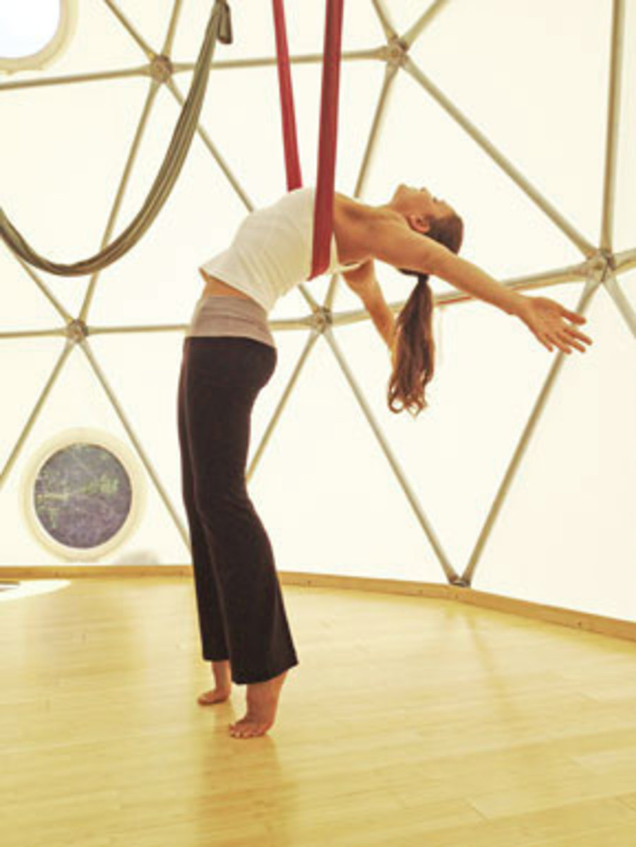 Anti-gravity yoga helps to undo the damage caused by gravity, while providing a strong strength training and cardiovascular workout.
