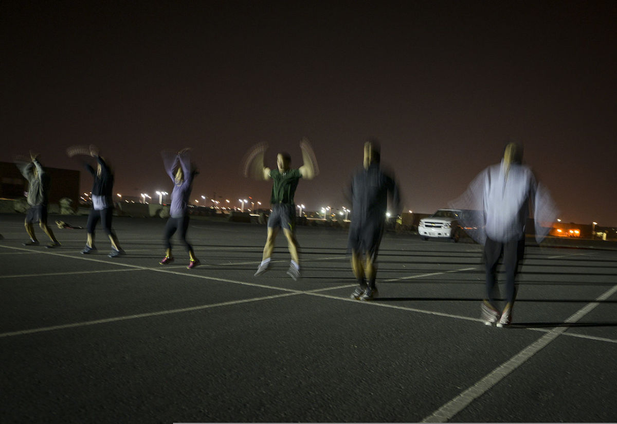 A crossfit workout performed outdoors.