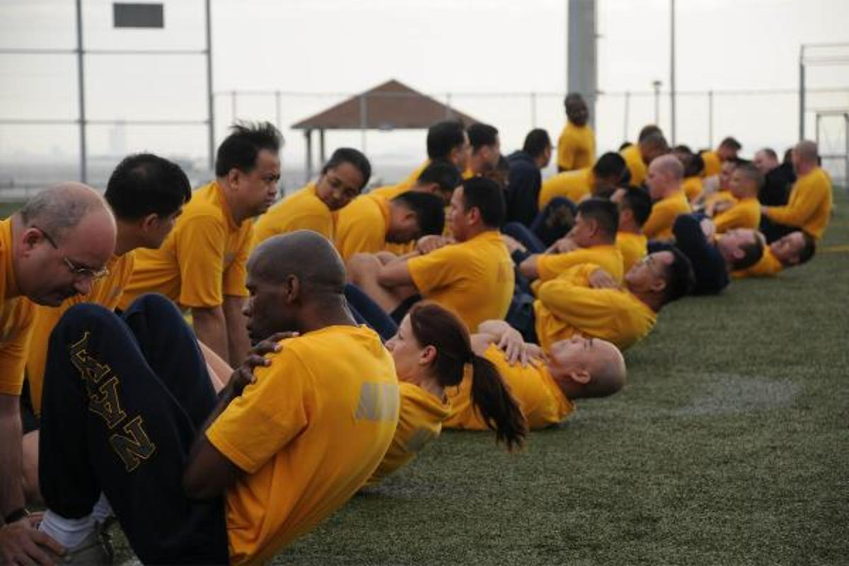 Sailors performing abdominal crunches, an exercise than can be performed nearly anywhere.