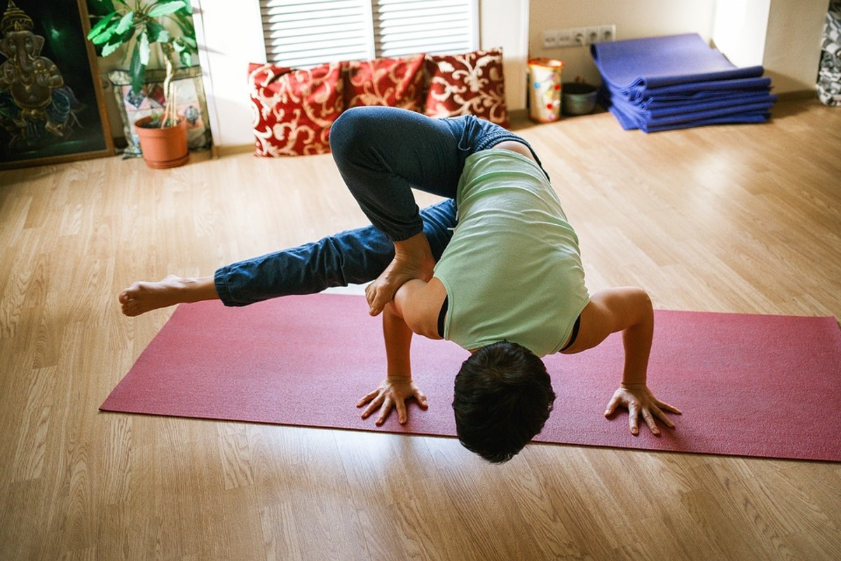Some people prefer to set up their own yoga space at home.