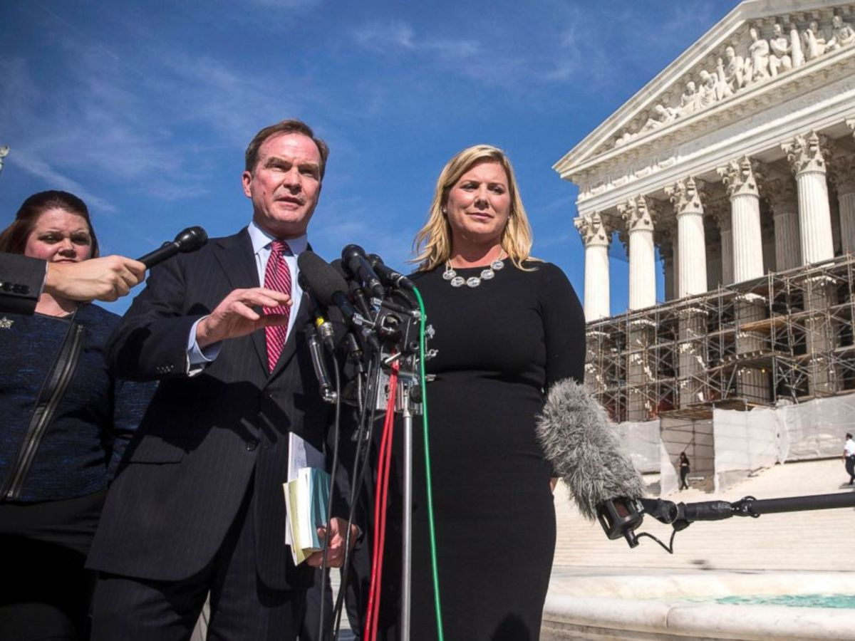 Michigan Attorney General Bill Schuette and Jennifer Gratz, CEO of XIV Foundationspeak, speak during a press conference outside the Supreme Court, Oct. 15, 2013, in Washington. Andrew Burton/Getty Images.