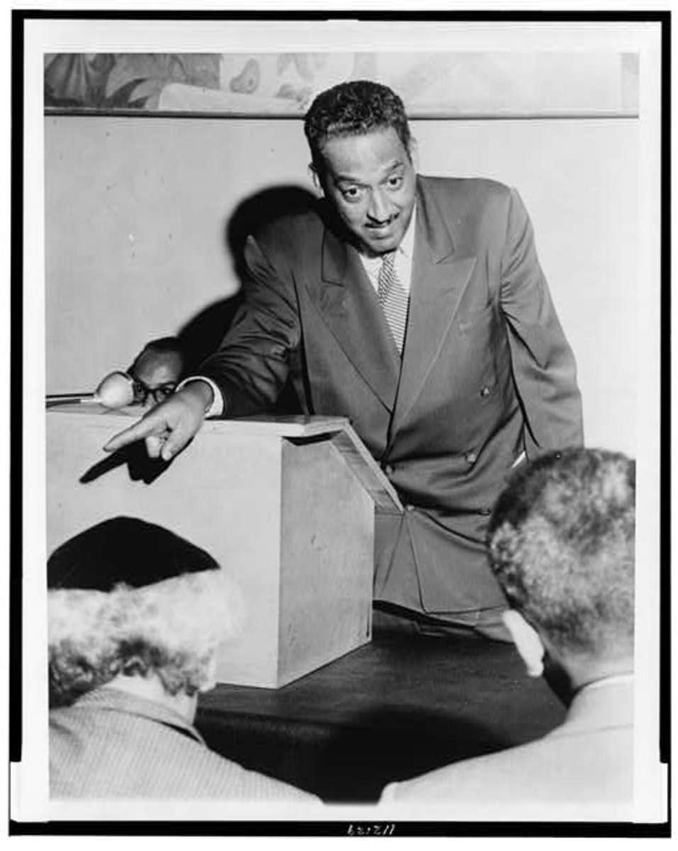 Thurgood Marshall, lead counsel on the case, explains segregation to the press.  He went on to become the first African-American on the Supreme Court.