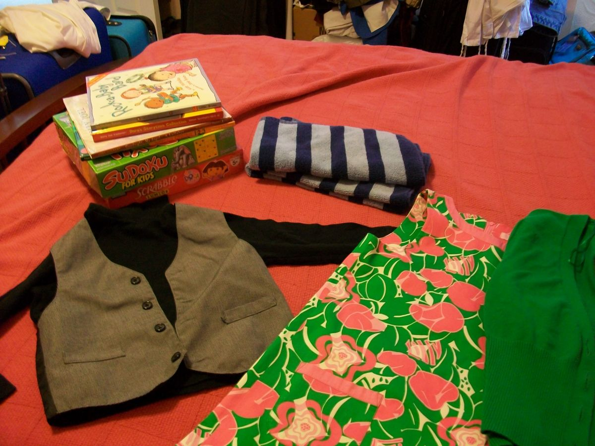 These are good items to donate. The clothes and towels are in good condition, the games have all their pieces, and the books don't have any teeth-marks on them.