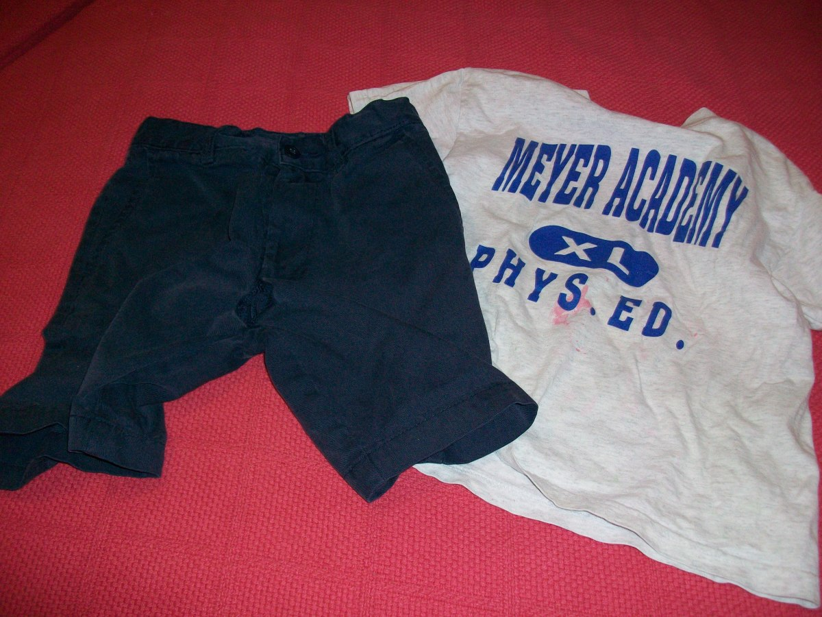 What NOT to donate. Note the mysterious pink stains on the shirt and the hole in the crotch of the shorts. How do these things even happen?