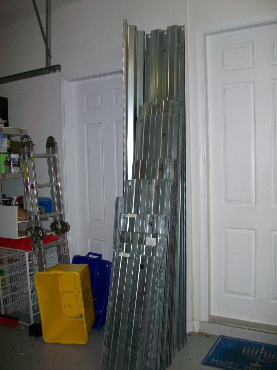 This is several hundred square feet of aluminum storm shutters we donated to our local Habitat ReStore. They carried them out to the truck for us, so no sweating or cutting our hands!