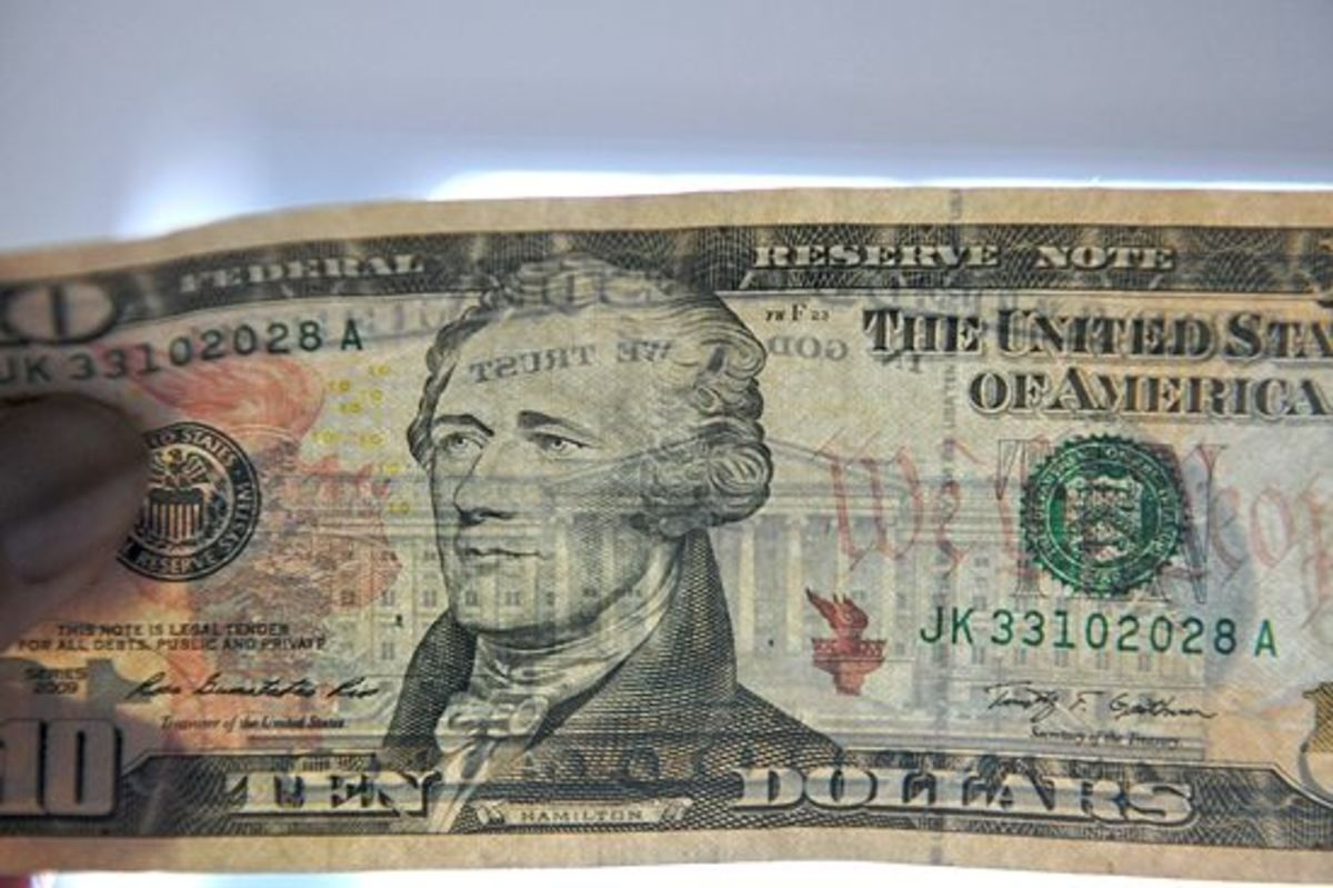 $10 bill with security strip (top to bottom, right of center)