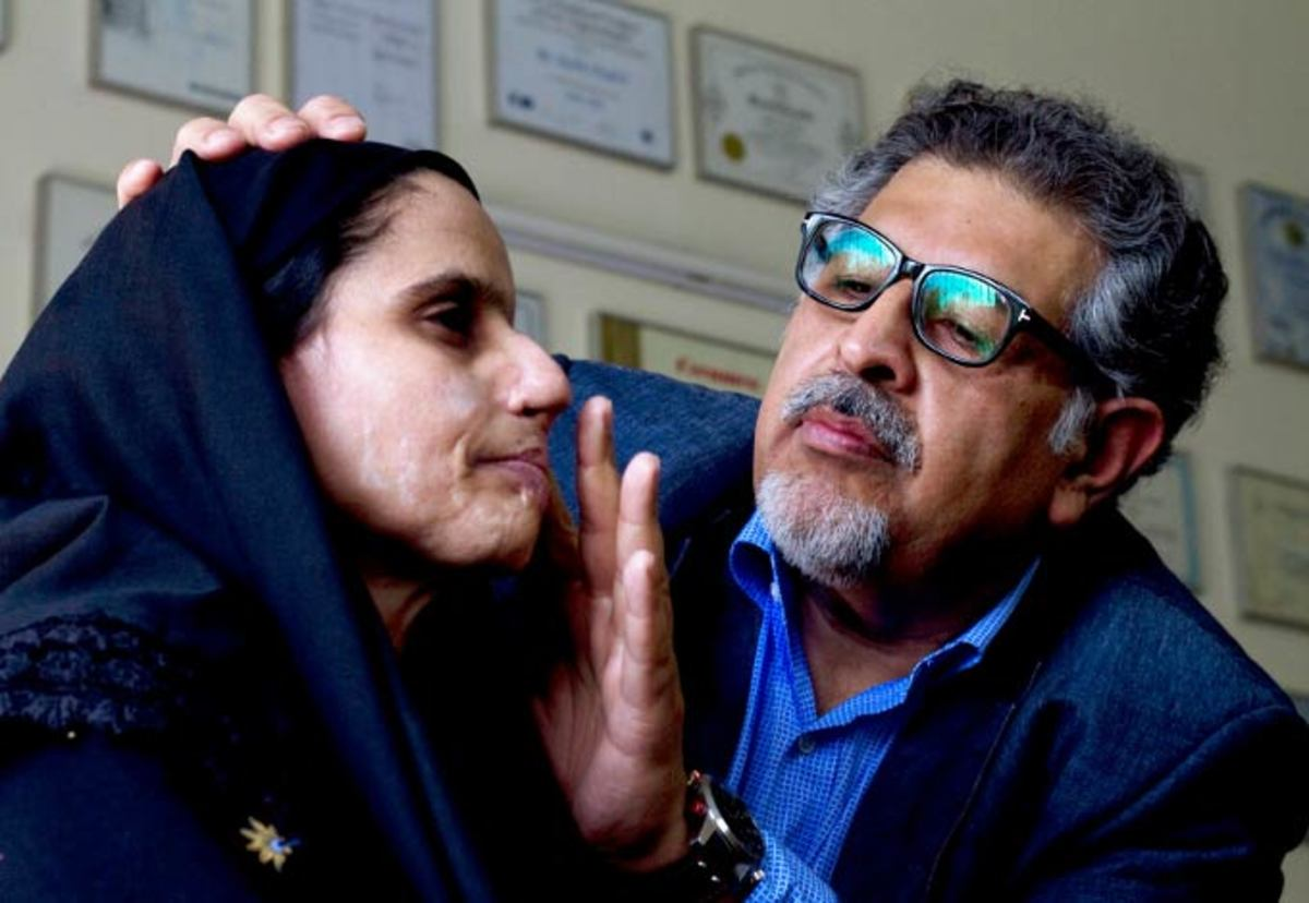 Dr. Jawad, a London plastic surgeon, attends to a victim of acid attack in Pakistan.