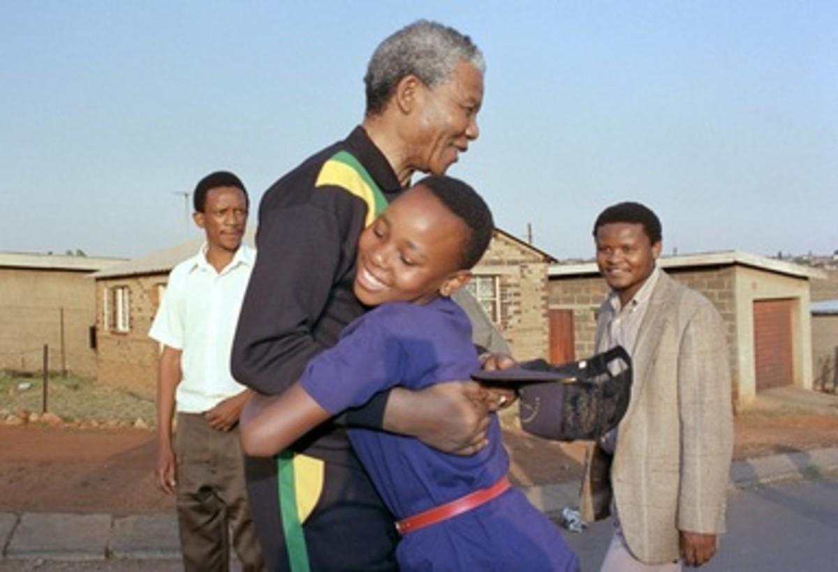 Mandela and child hugging