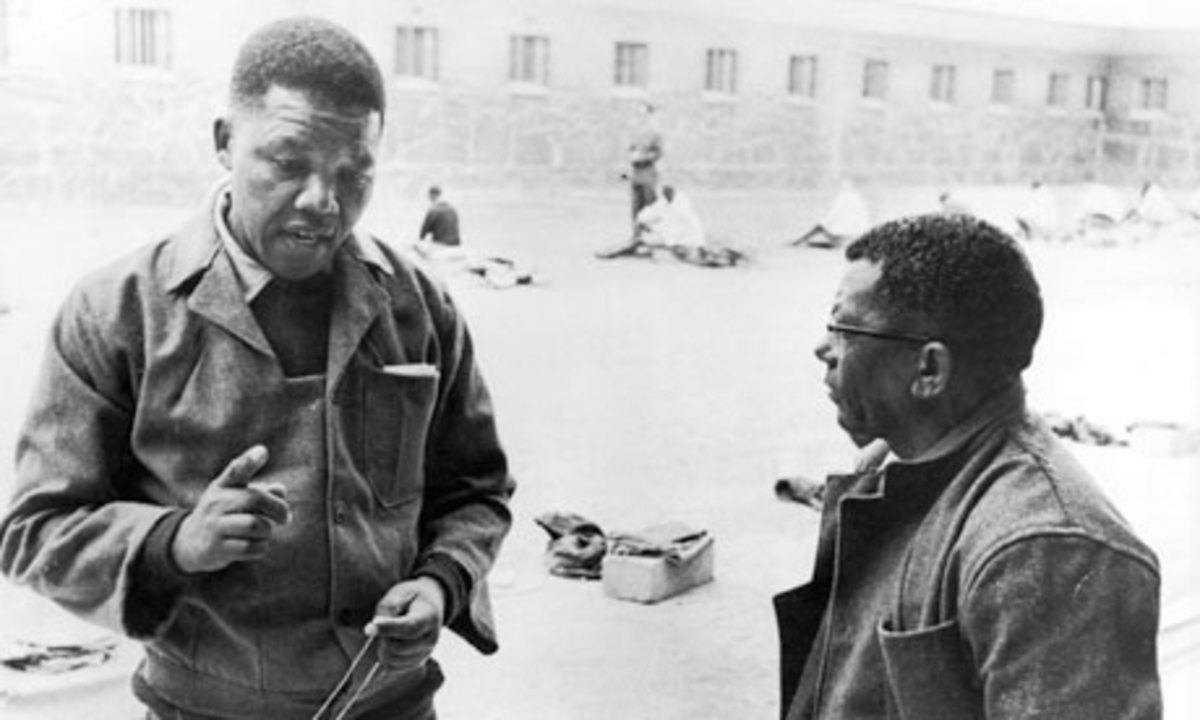 Nelson Mandela and Walter Sisulu in the prison courtyard on Robben Island.