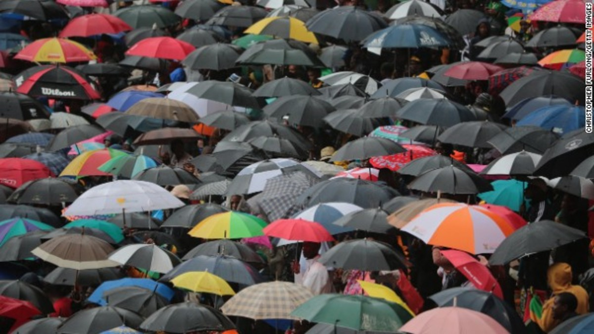 People taking shelter during Mandela's commemoration at FNB stadium