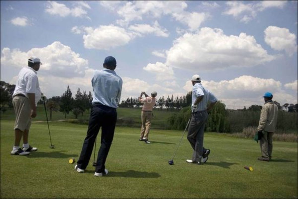 Black elites takes a swing during a game of golf with his friends at the Louewkop Golf Course in Sunninghill, Johannesburg, South Africa.