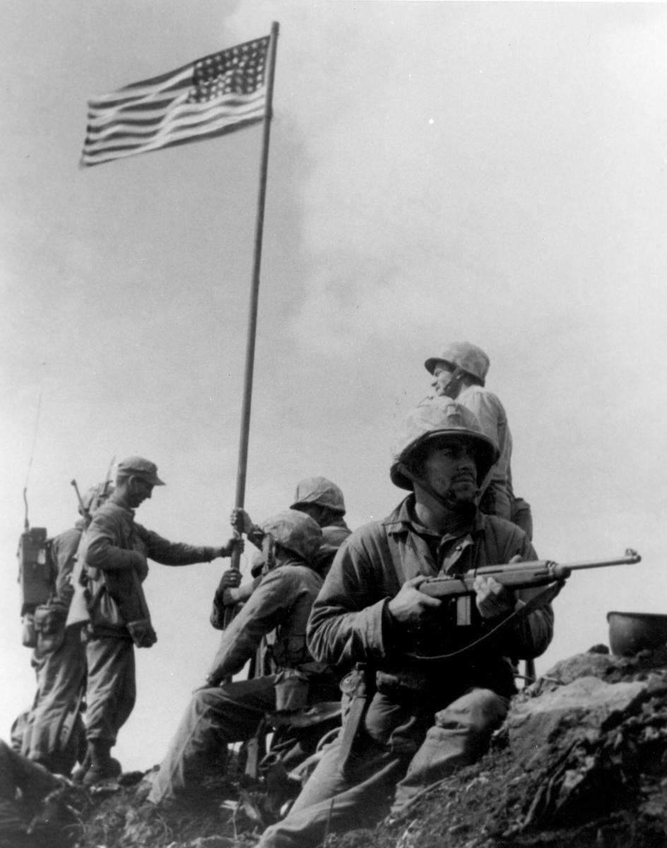 First Iwo Jima flag raising.  Robeson (not visible in this version), Schrier, Jacobs, Hansen, Thomas, Bradley, Michels, Lindberg.