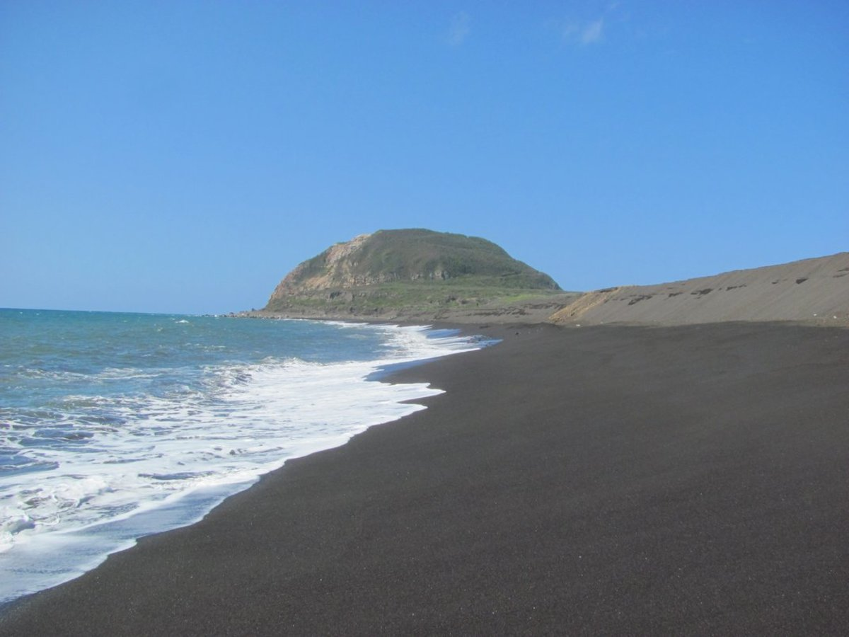 The famous black sands of Iwo Jima, with deadly Suribachi in the background.