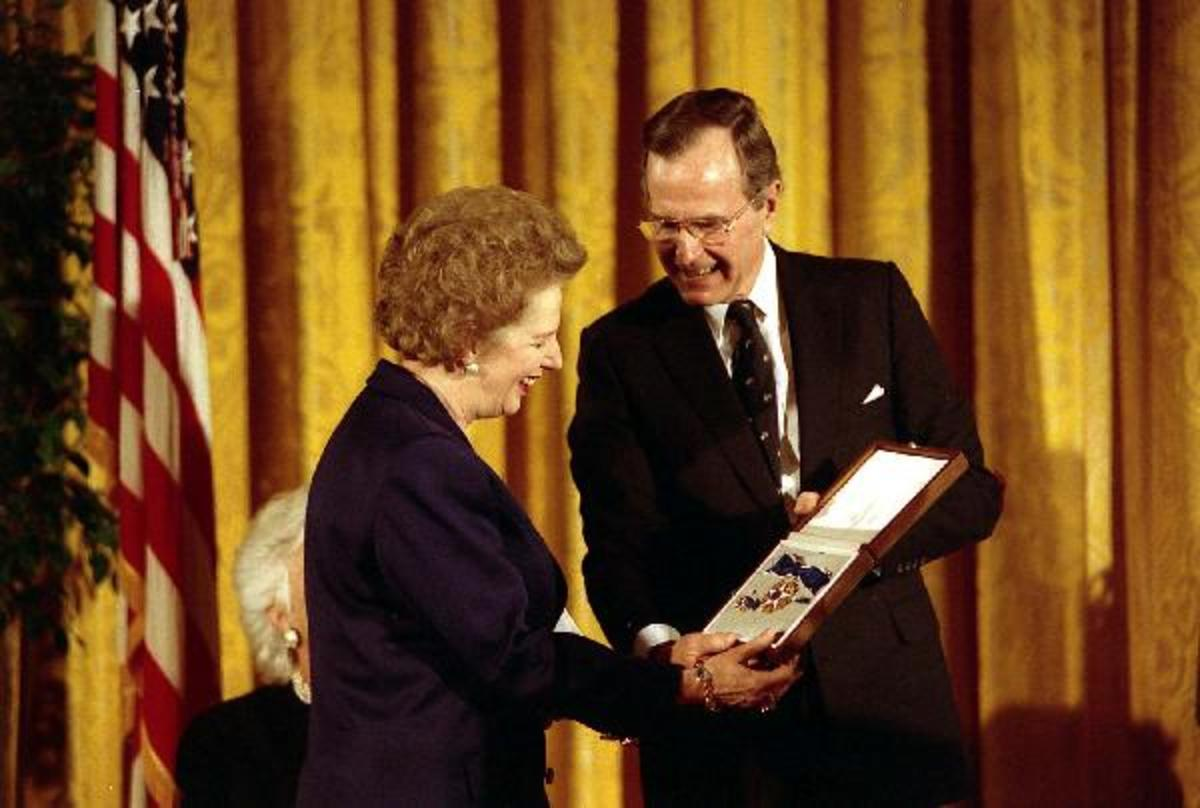 1991. U.S. President George H. W. Bush awards former U.K. Prime Minister Margaret Thatcher with the Presidential Medal of Freedom, the highest civilian honor awarded by the United States.