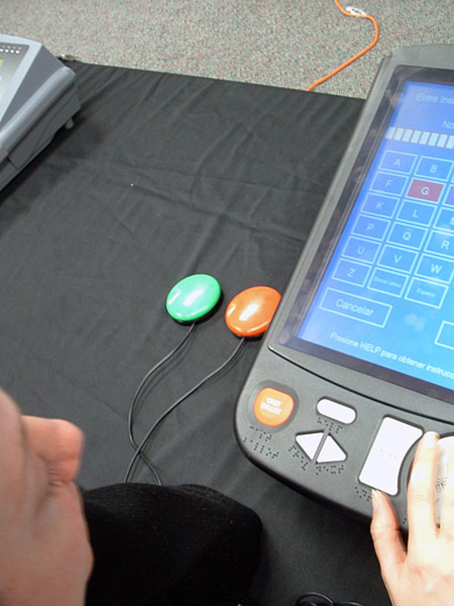 "An accessible voting machine with ""jelly buttons"" which make the machine accessible for voters with manual dexterity disabilities.    Image provided by Joseph Hall under Creative Commons Attribution-Share Alike 3.0 license."