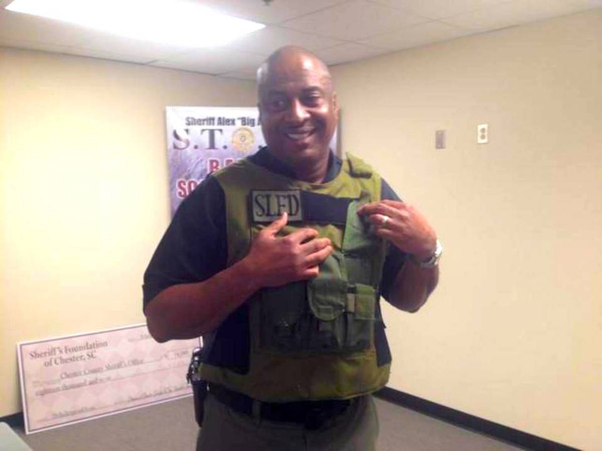 """""""Big A"""" in vest that may have saved his life."""