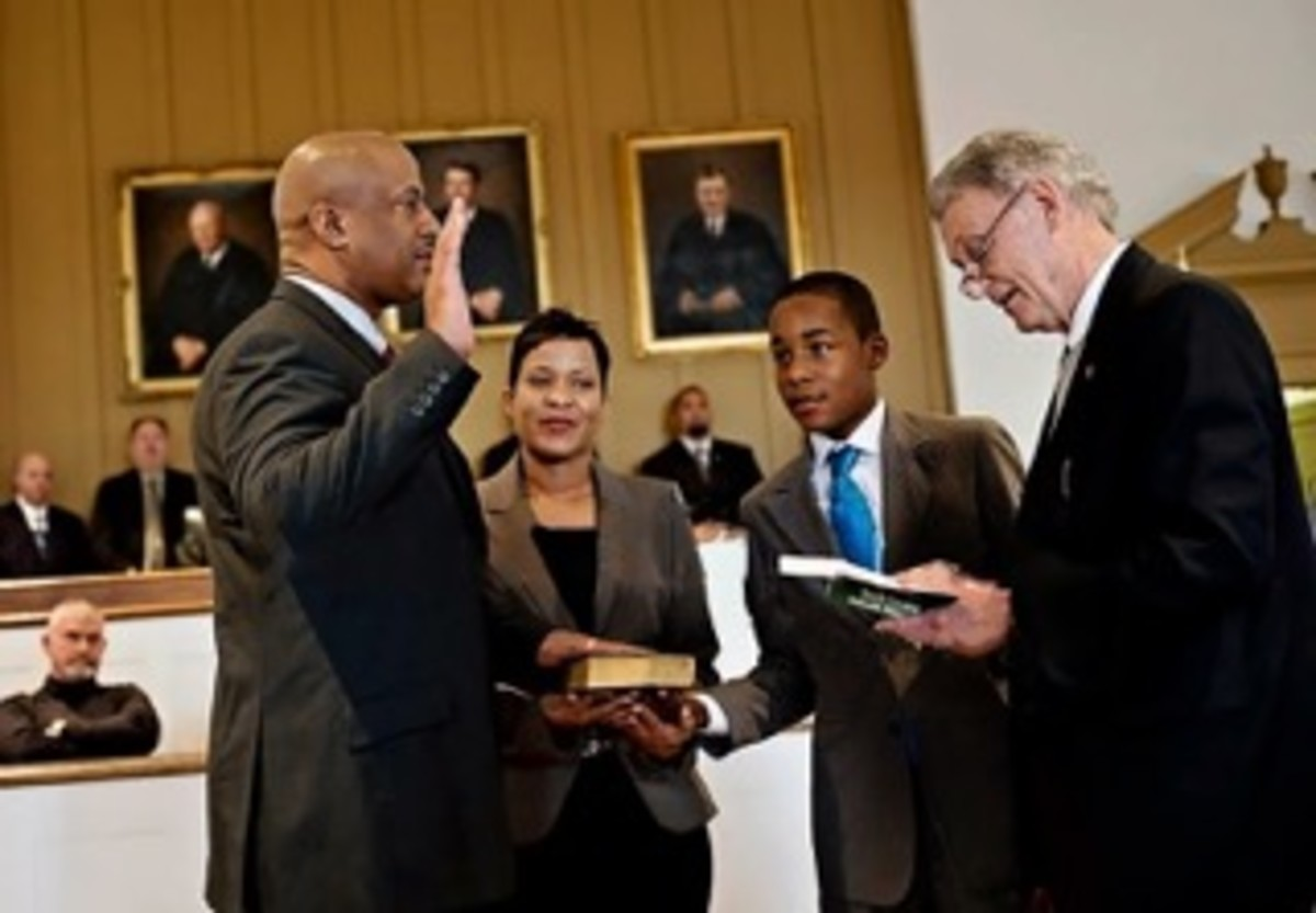 In 2012, Alex was sworn in as the first African American Sheriff of Chester County, S.C. with his wife Angel and son T.J. by his side.