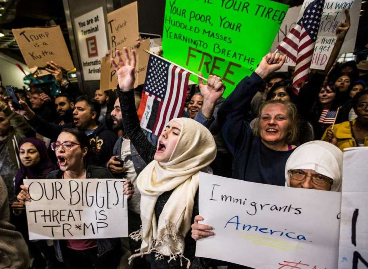 This is how far we've come and the hope of the future.  While some support the current ban, many from all backgrounds fight it and come together to do so. It's stark contrast to the conflicts and racism between immigrants not too long ago.