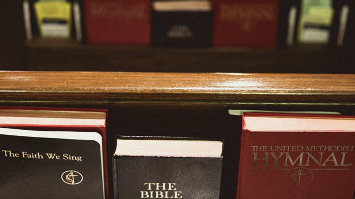 Back of pews with Bibles and hymnals