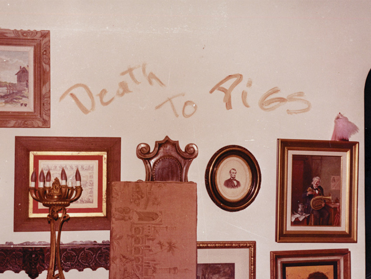 """Death To Pigs"" scrawled on the living room wall in Leno's blood."