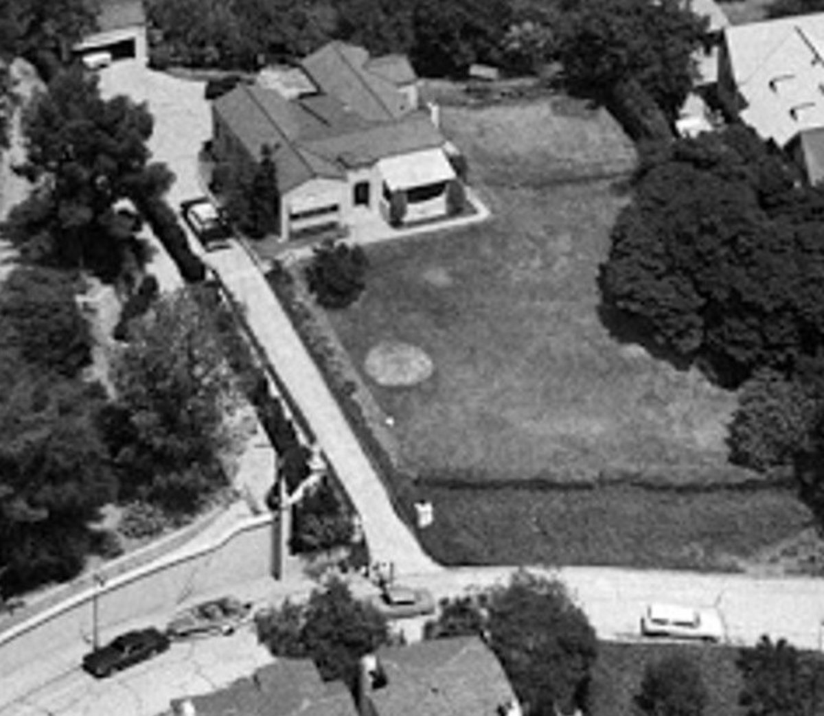 TV news helicopter shot of the LaBianca residence. Leno's Thunderbird and boat can be seen on the left.