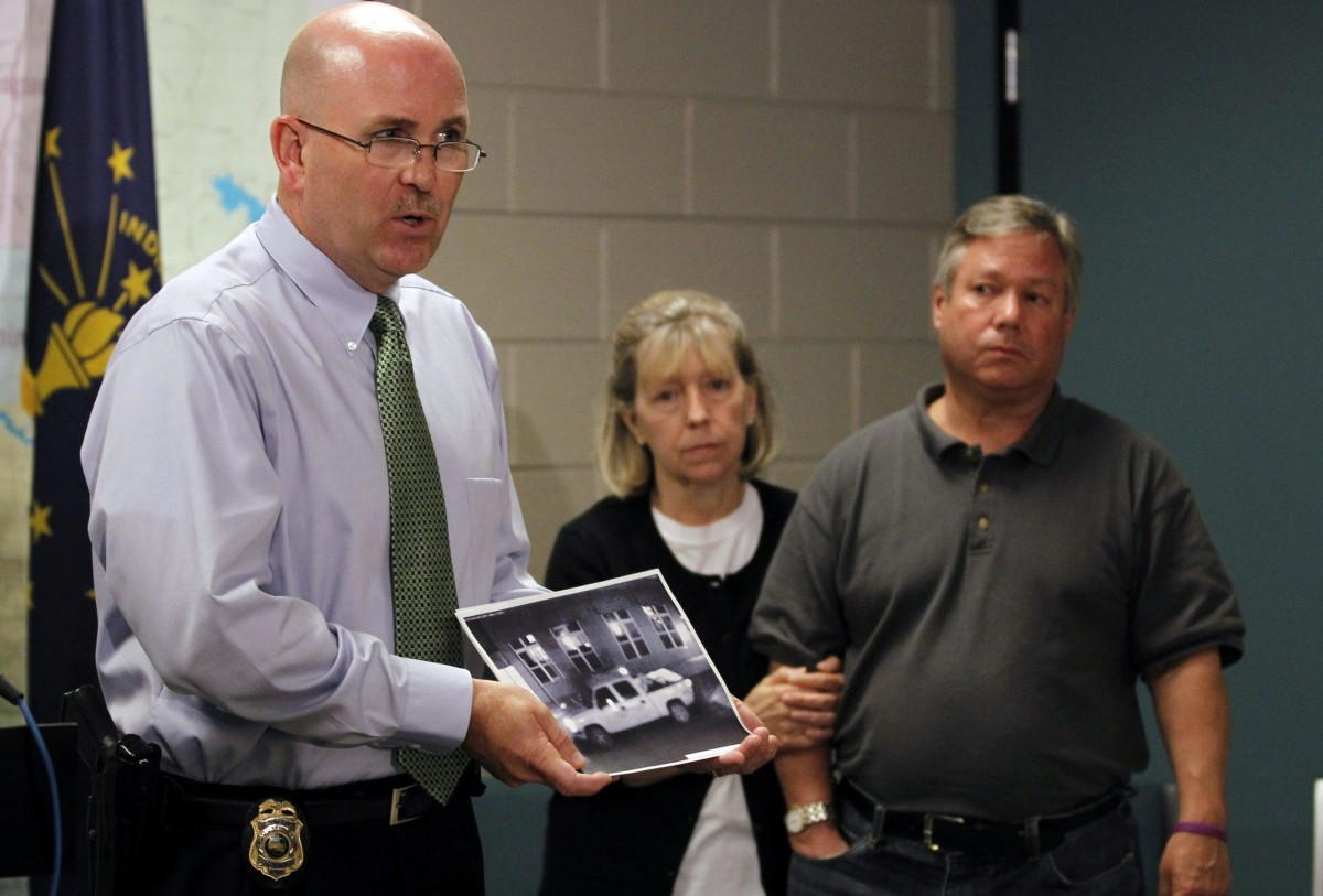 Captain Joe Qualters of the Bloomington Police Department displays video surveillance photograph  of a vehicle seen in the area on the night Lauren Spierer vanished.