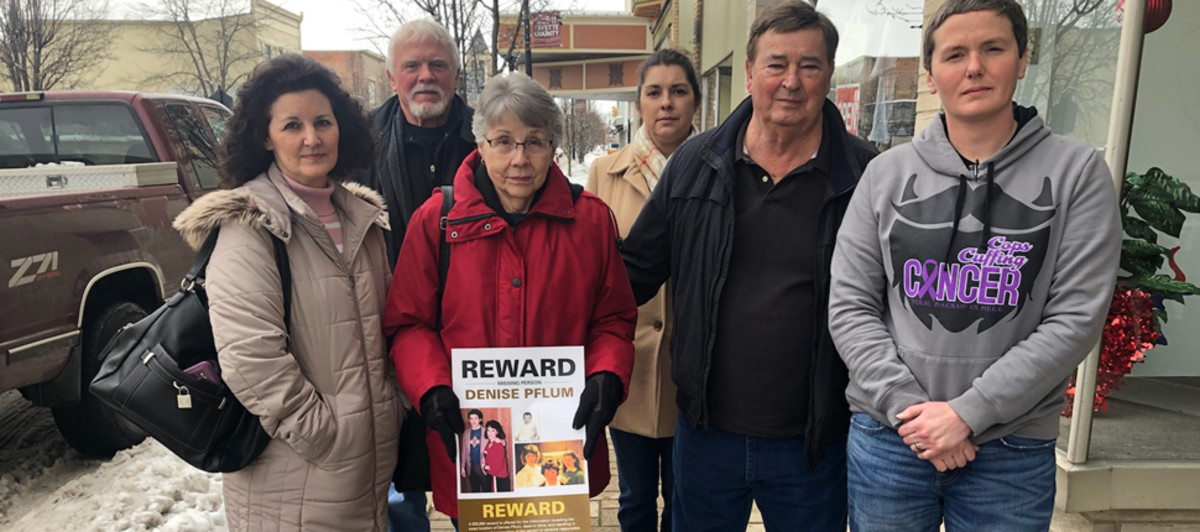 David and Judy Pflum with family and law enforcement distributing fliers on what would have been Denise's 51st birthday on January 14, 2018.