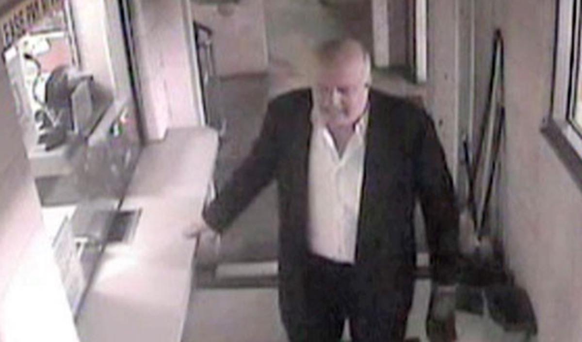 John P. Wheeler on video surveillance walking without his coat and carrying one shoe in the Hotel DuPont parking  area. Photo courtesy of Newsweek.