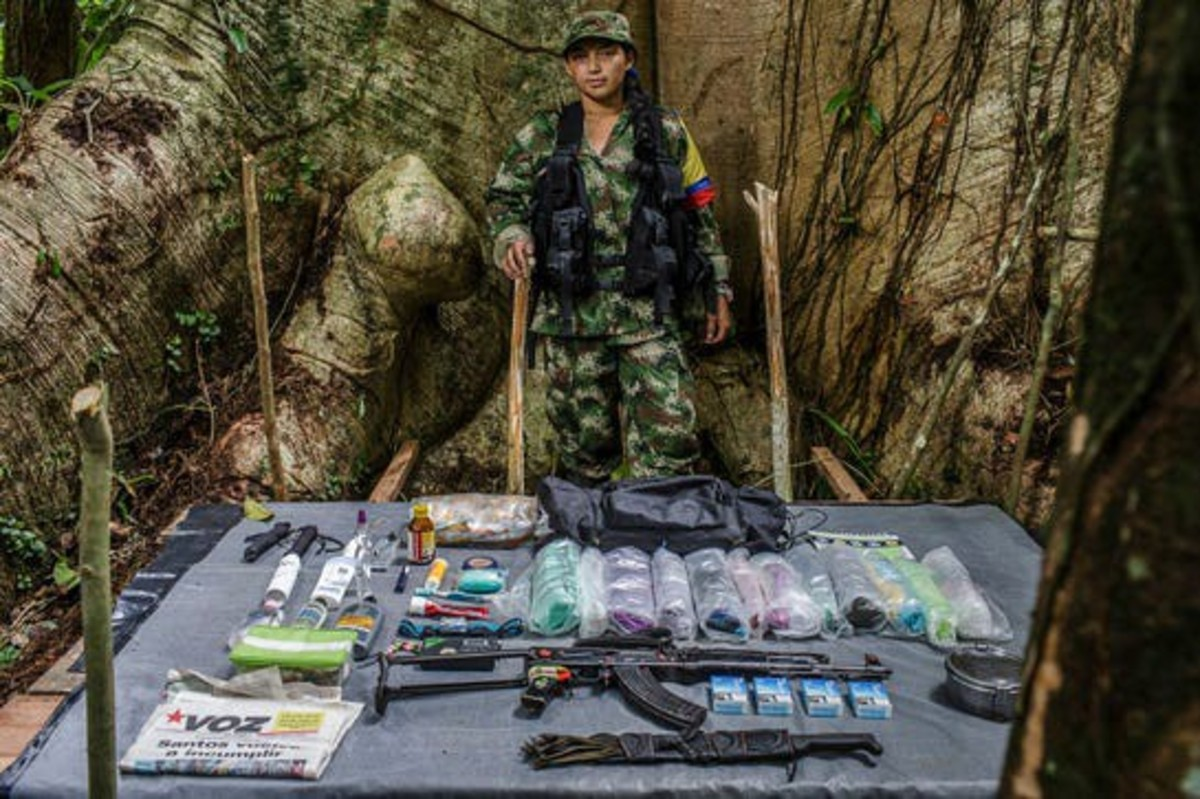 Typical armament a woman guerrilla of the FARC carries.