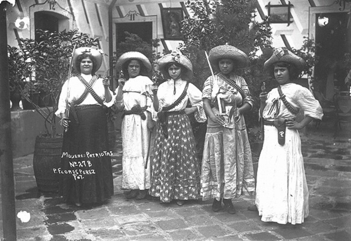 Female soldiers of the Mexican Revolution known as soldaderas. On the far right is Petra Herrera, who disguised her gender by calling herself Pedro Herrera. She was known for being a leader and blowing up bridges.