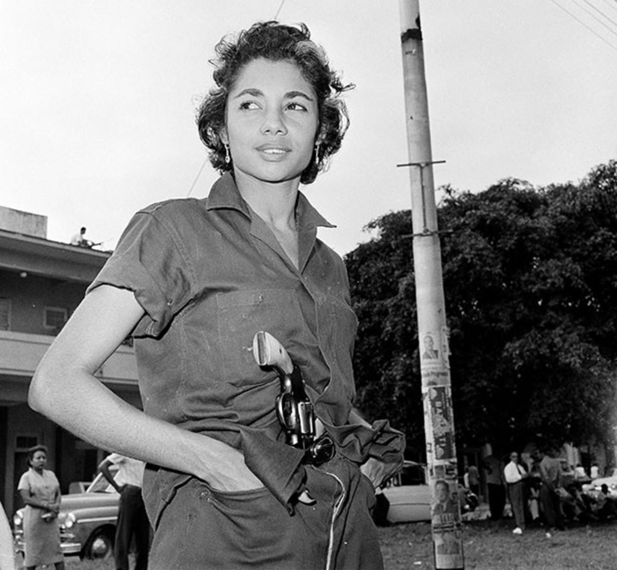 Young woman patrols the streets in post-Batista Havana.
