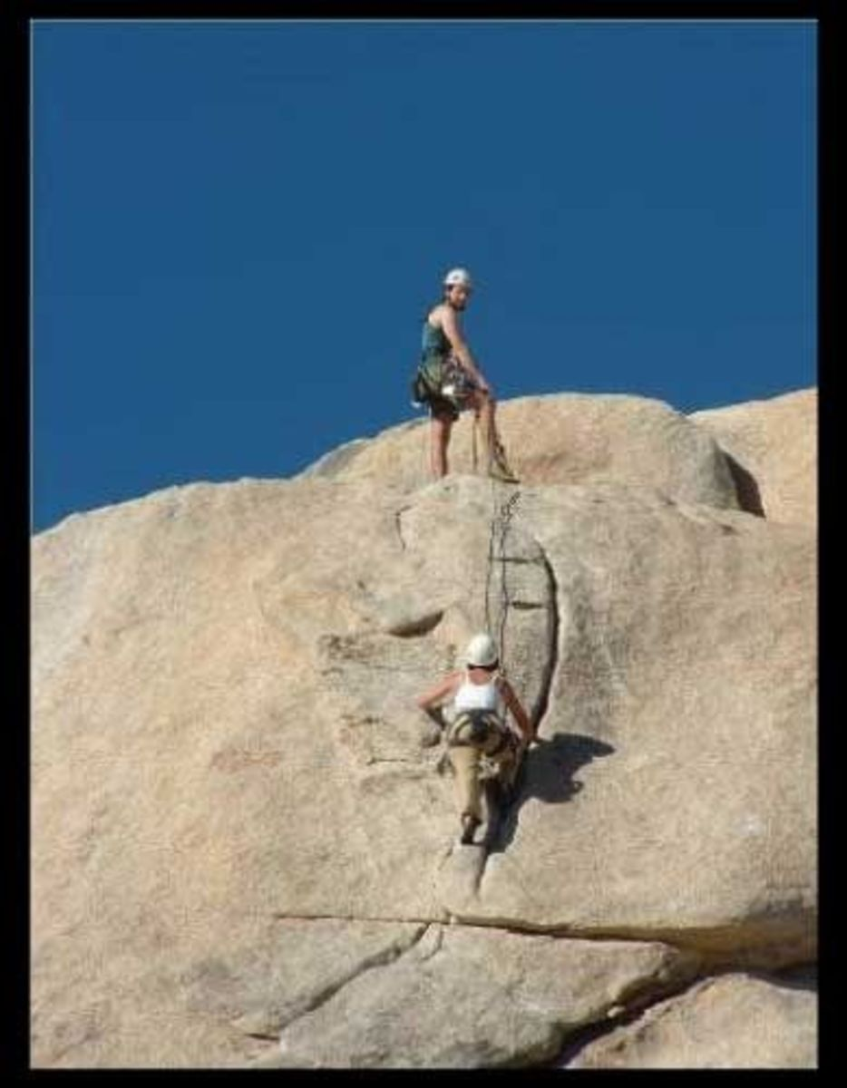 "AMGA-certified guide Martry Molitoris, with Alpine Endeavors, belays his client on the JTree classic route, ""Toe Jam."""