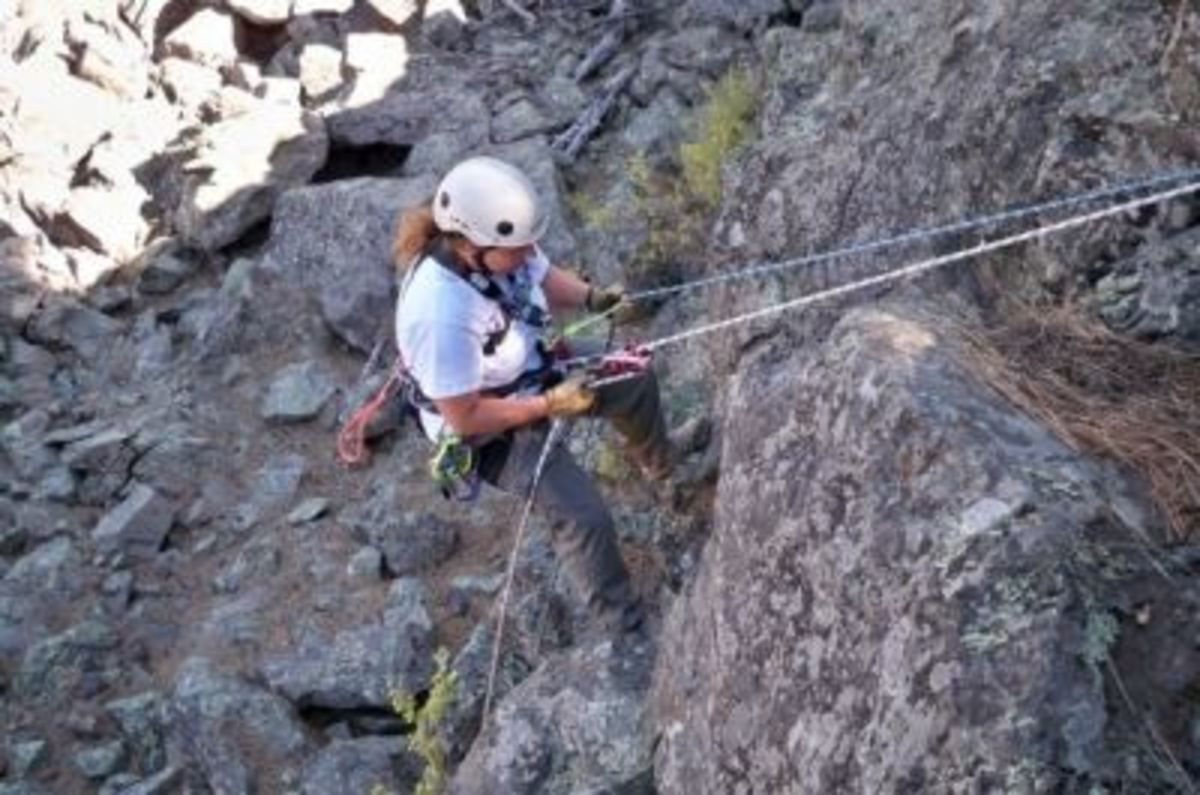 Me, rappelling with a brake rack and a conditional self-belay