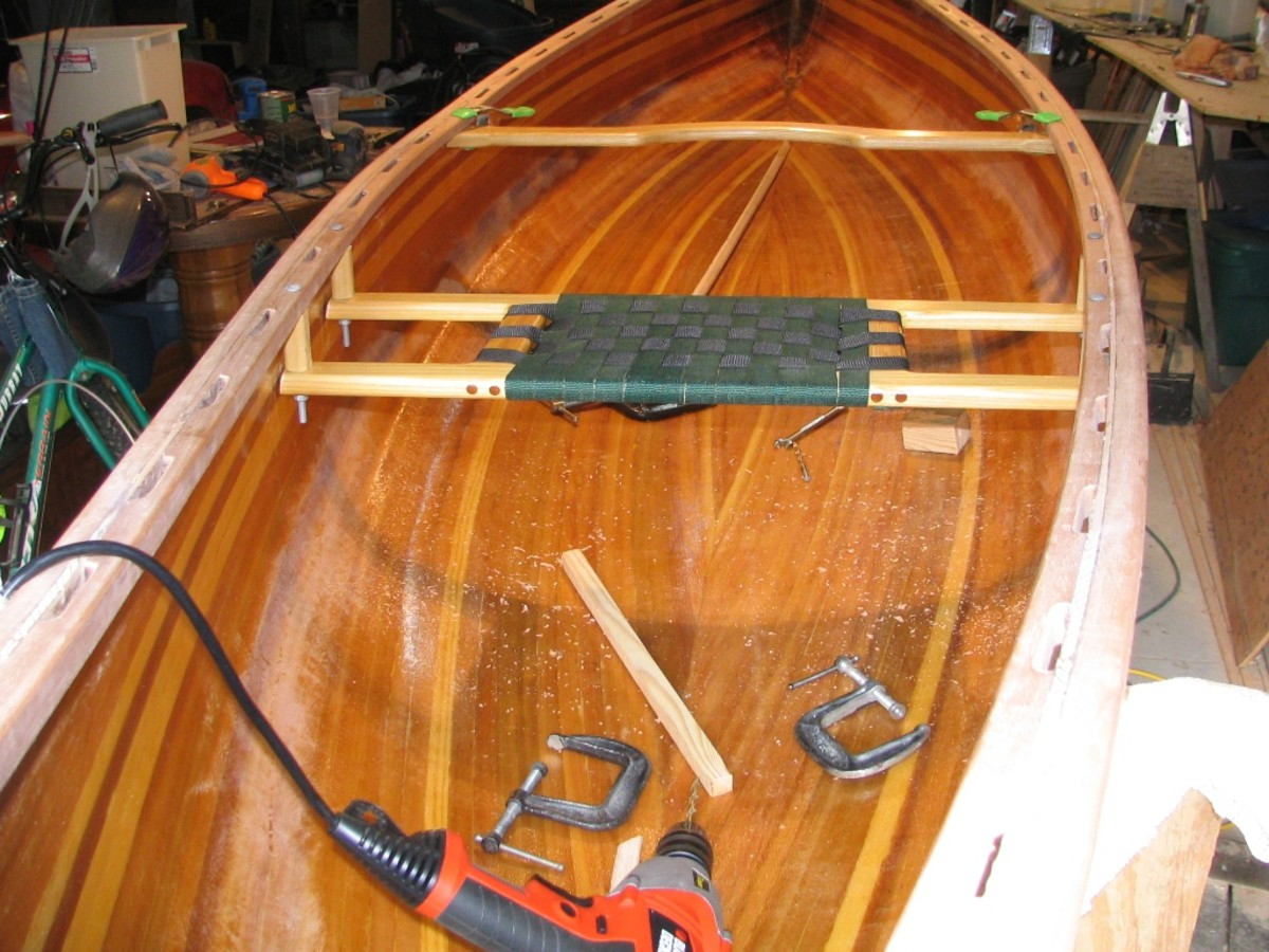 attaching the seats to the canoe gunnels