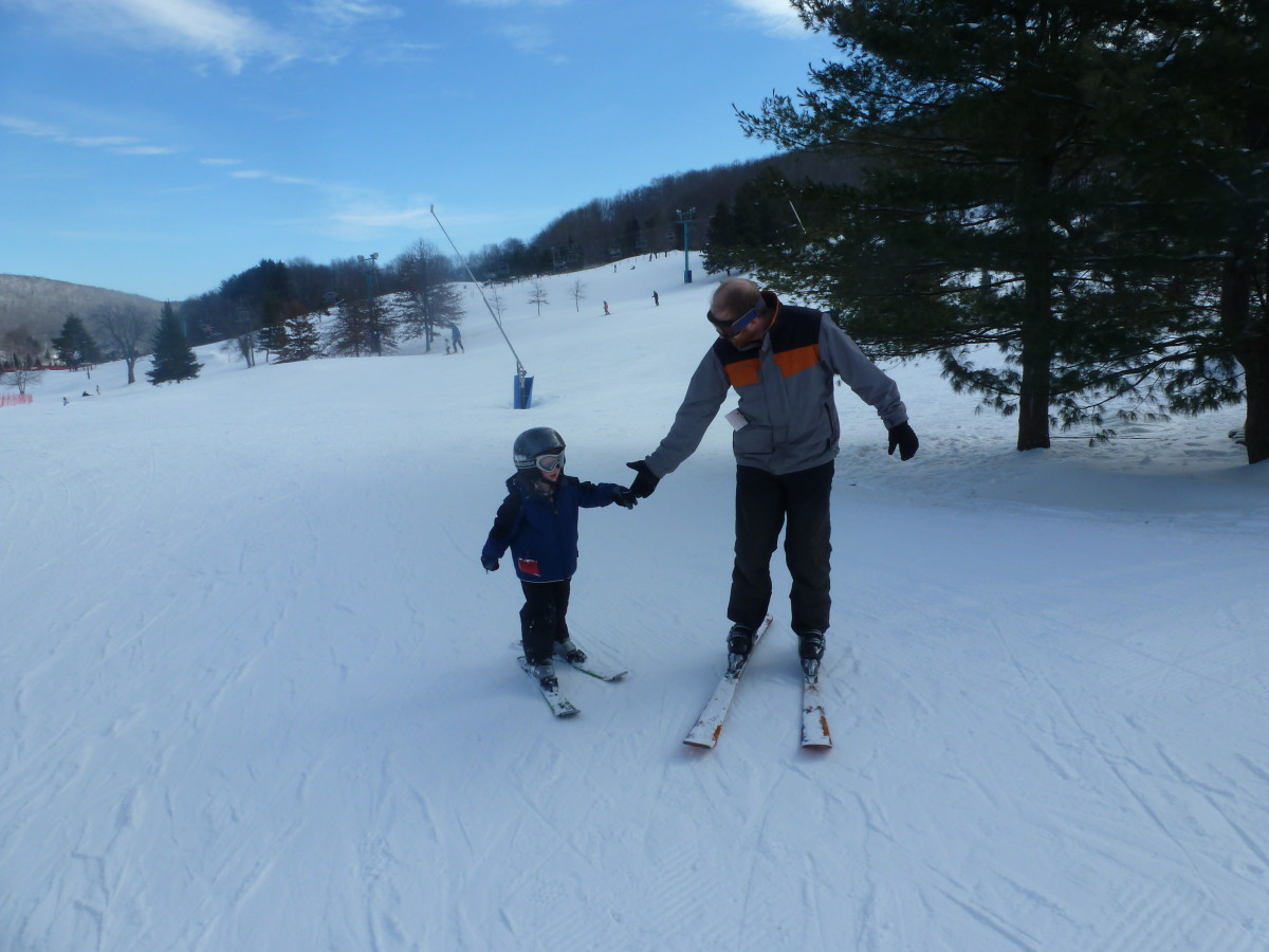 Small children often have difficulty when skiing on completely flat terrain. A helping hand (or extended ski pole) will help pull them across the flats to the lift.