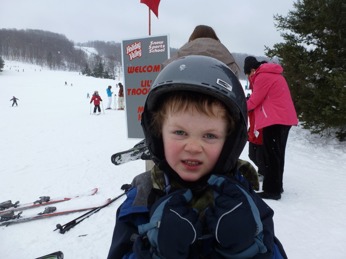 Helmets are vital safety equipment for young skiers.