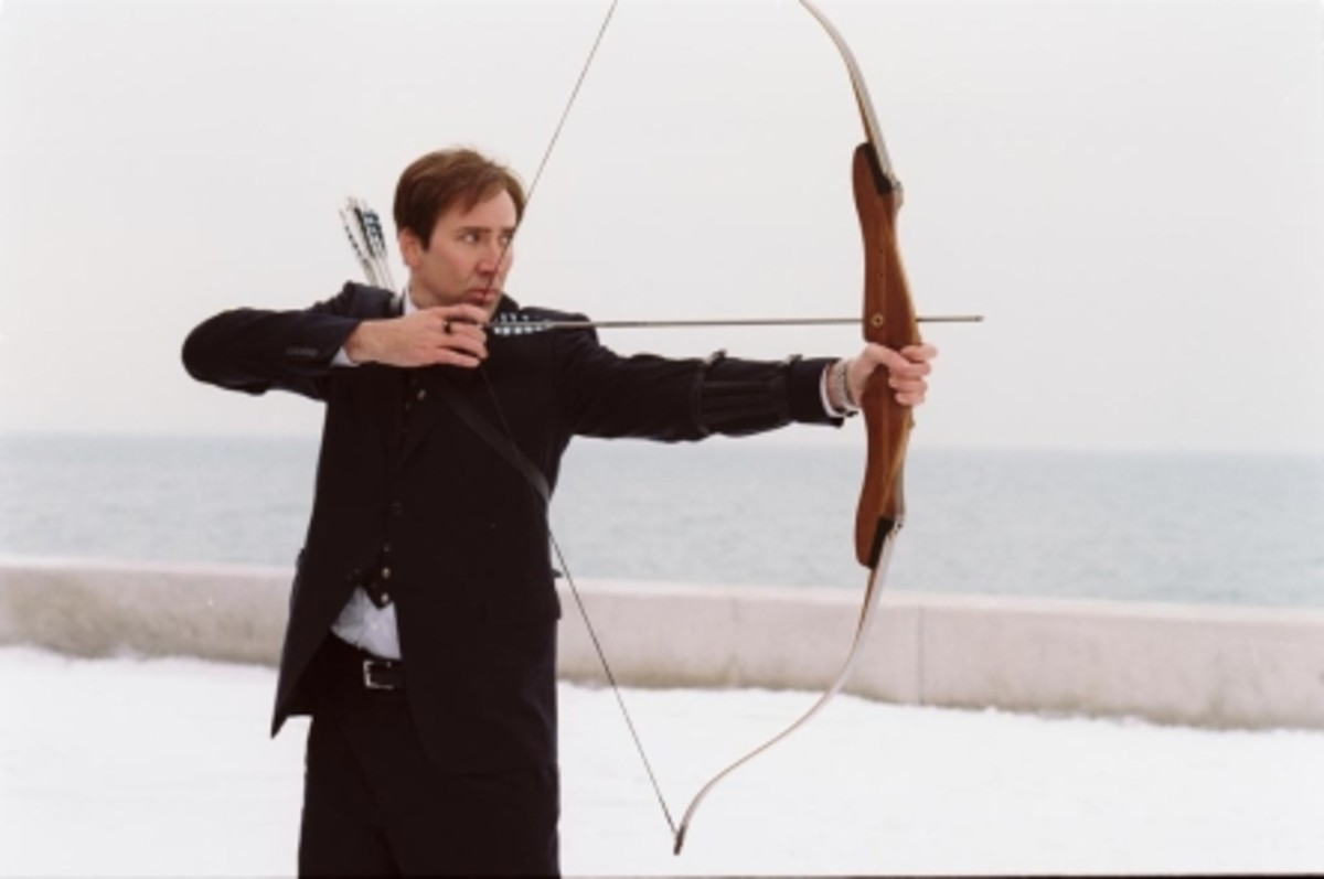 Nicholas Cage from the movie The Weather Man practicing archery to gain self-confidence and achieve wellness in his life.