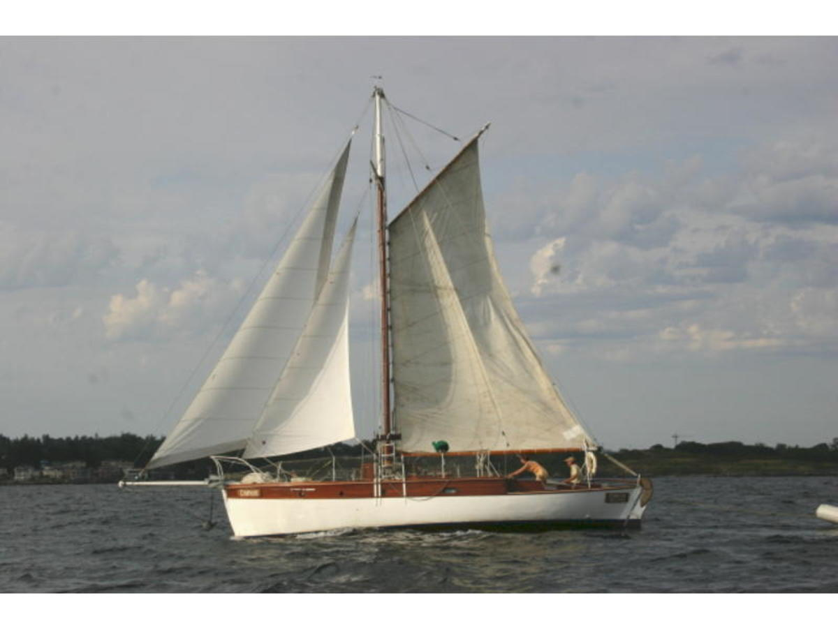 Note the 4 cornered main sail.  The two head sails means that this is a cutter rig as well.