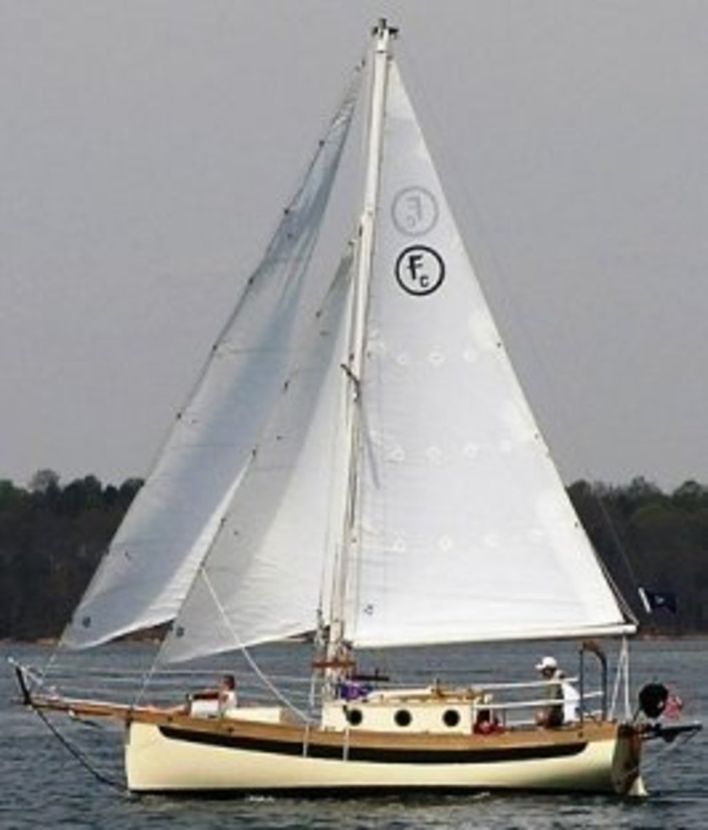 A small cutter rigged sailboat.  Note the two head sails.