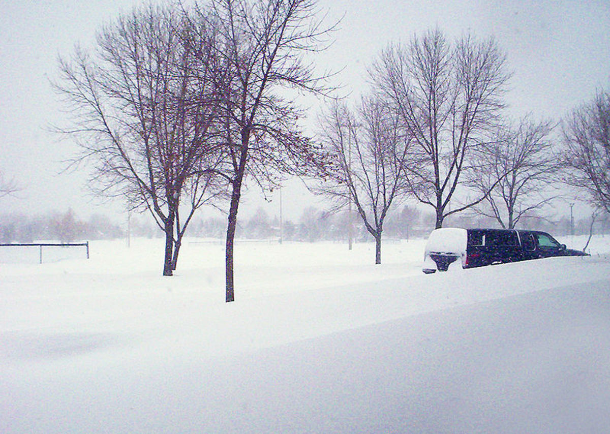 Blizzard snowfall amounts could easily bury a campsite.