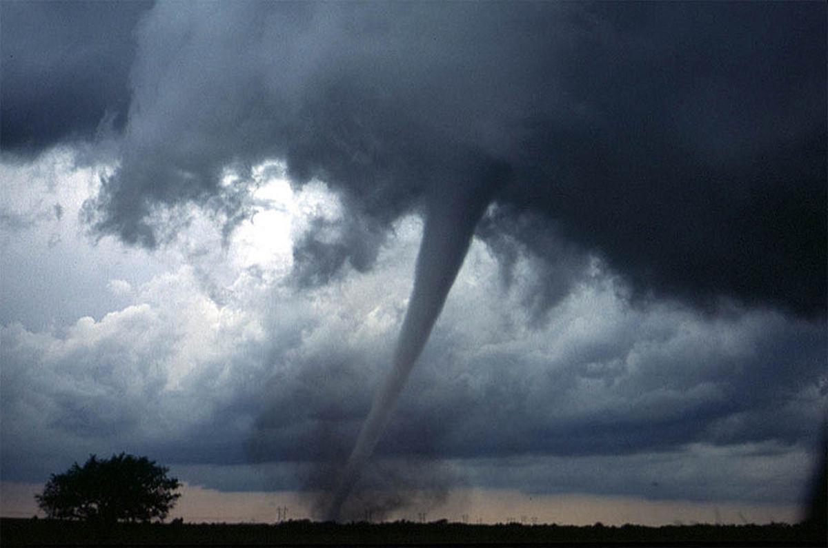 A tornado tears through the countryside.