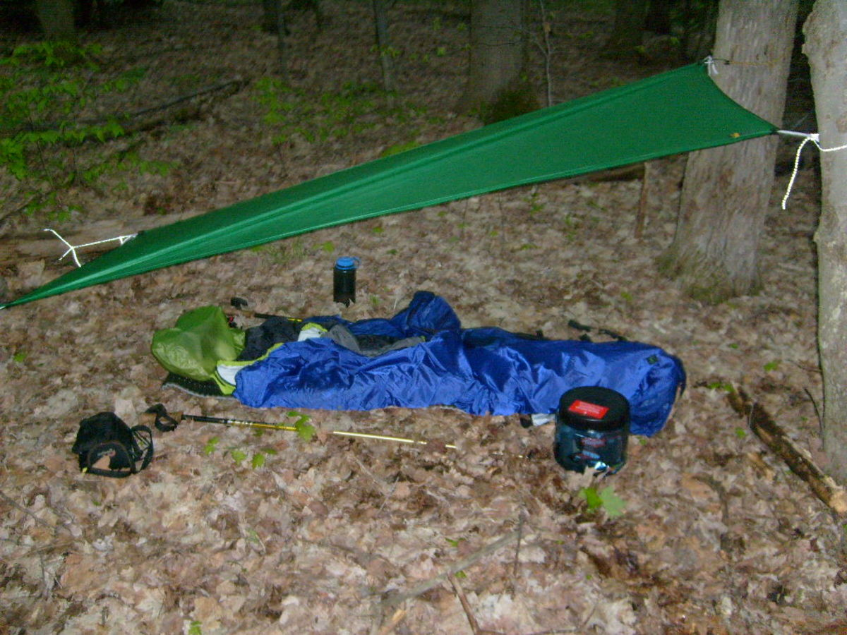 Solo camping is simple as seen by my lightweight campsite on the Eastside Overland Trail.  Tarps are great for experiencing a oneness with nature.