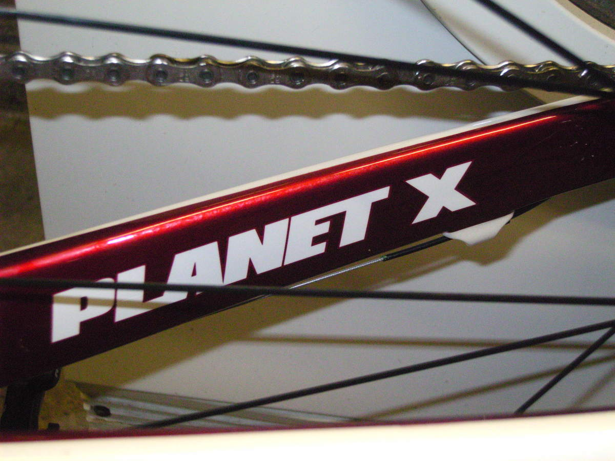 Chunky Chainstays emblazzened with the Planet X Logo on the RT57