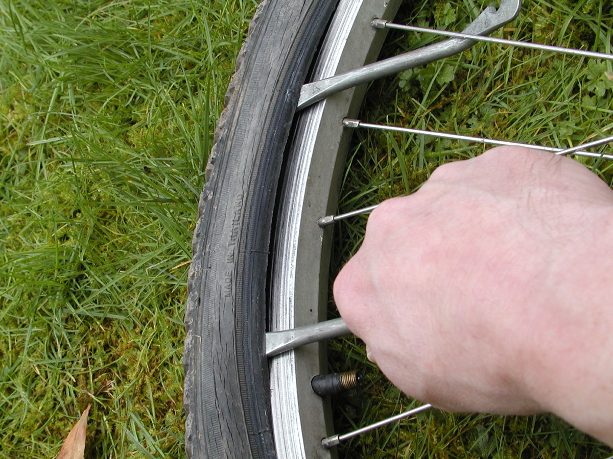 Slide the tire lever along the bead to release it. You may need to lever out further sections of the tire, bit by bit with the second lever before it is possible to do this, especially if the tire is a tight fit or rigid due to low temperatures