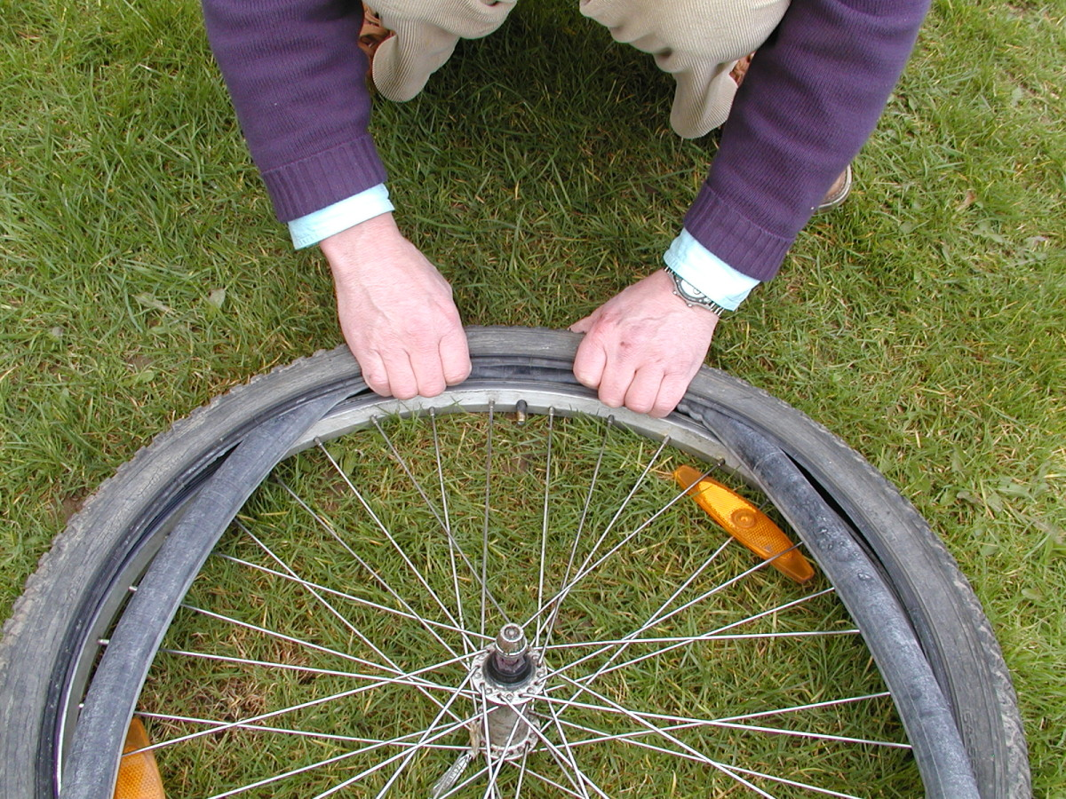 Feed the tube into the tire and thread the valve through the hole in the rim