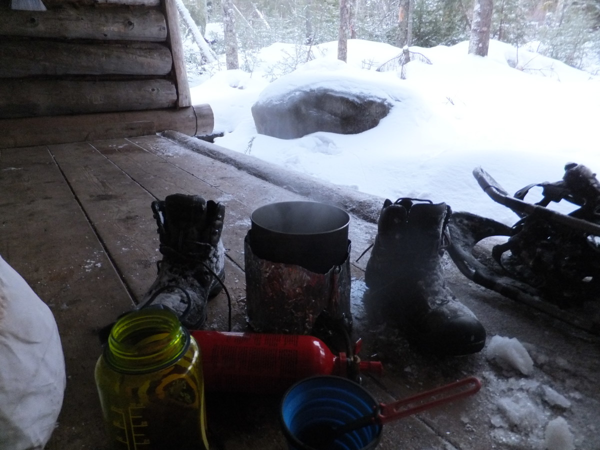 Melting snow and drying boots at McMartin lean-to.