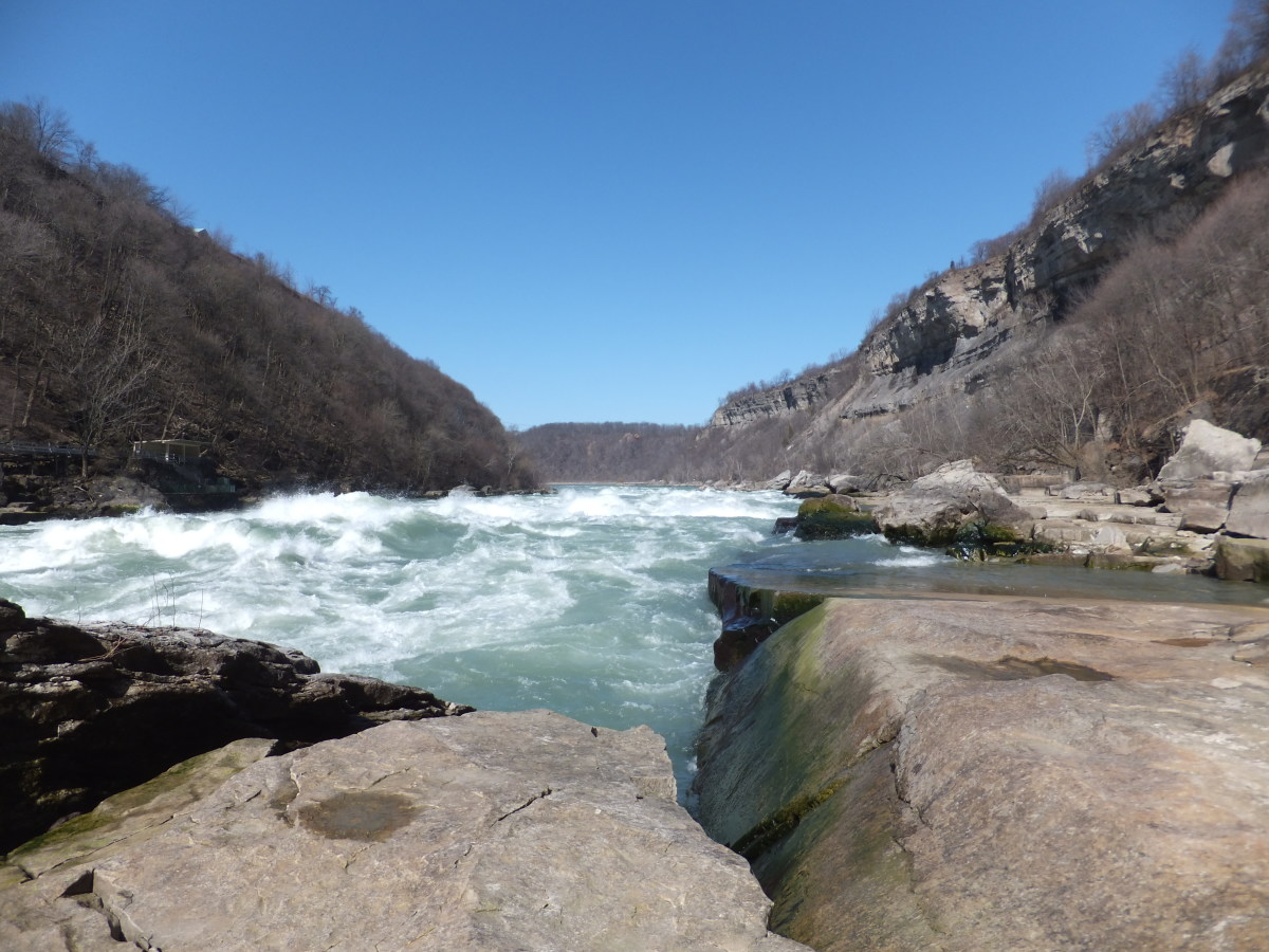 The Niagara Falls Gorge where I often hike, is rocky and slippery.  You need a medium weight hiking boot with good durability and great traction.