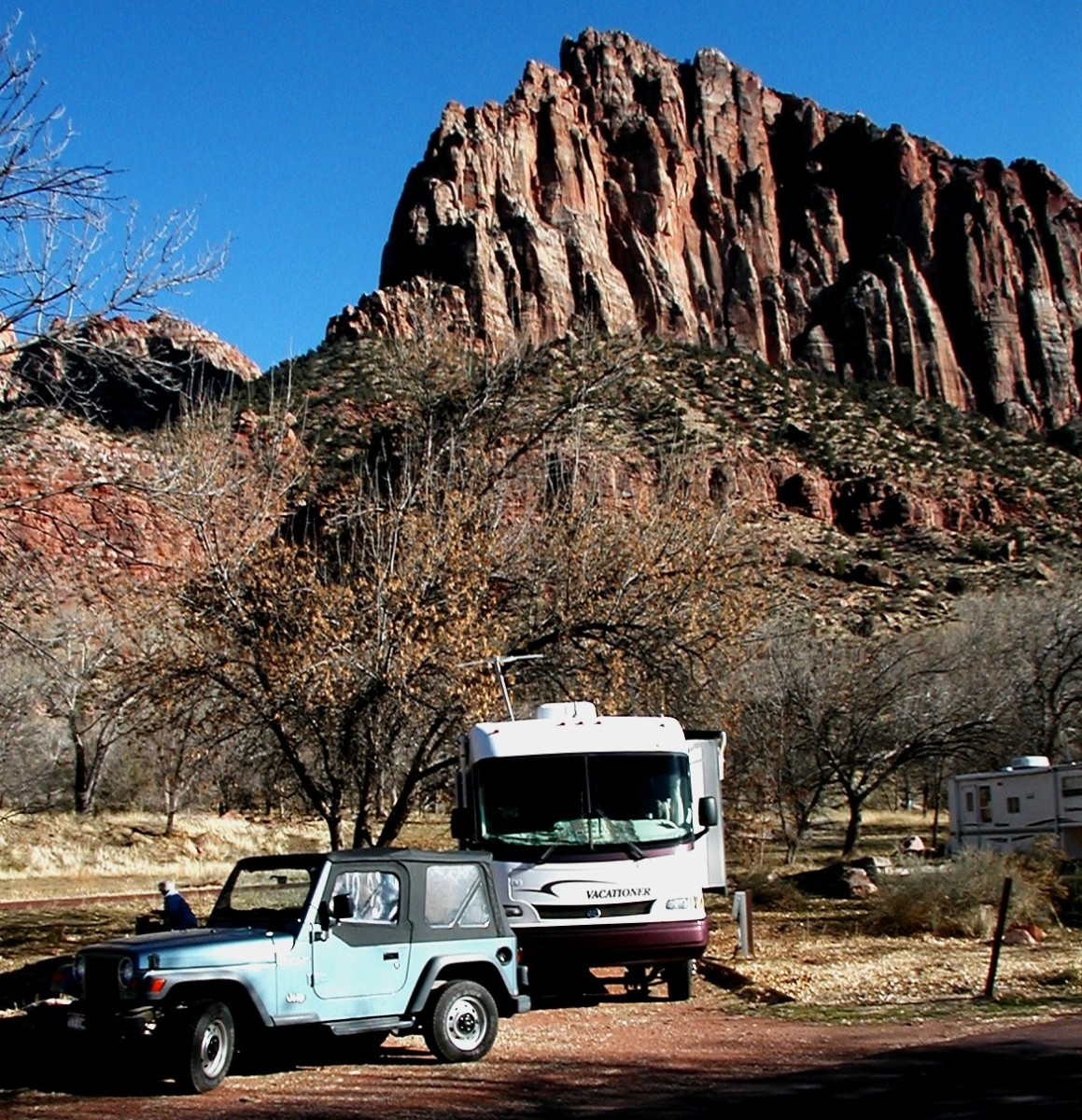A perfect off-the-grid campsite at Zion National Park with beautiful rock formations in the background.